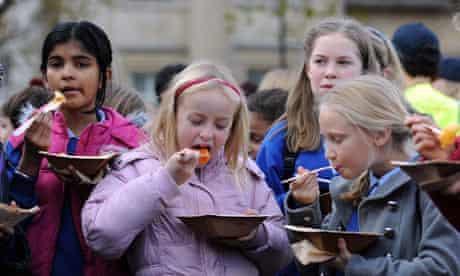 Children eating curry as part of Feeding the 5,000 event in Trafalgar Square
