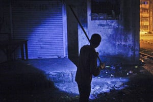 24 hours: a boy searches for rats outside a residential complex in Mumbai