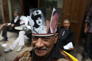 24 hours: Pictures of former president Gamal Abdel Nasser worn by a protester