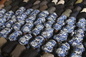 24 hours: Iranian soldiers perform Friday prayers at the Tehran University campus