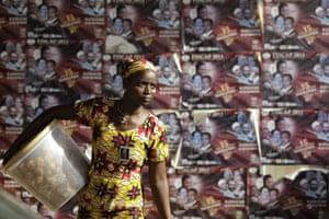 24 hours: A food seller in an underpass hawks her wares in Benin, Africa