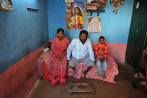 24 hours: Indian disabled man Narising Rao, poses with with his children