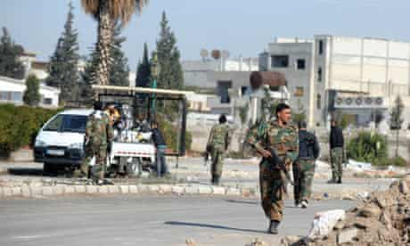 Syrian soldiers guarding the streets of Homs