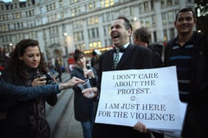 Signs at Occupy London: here for the violence
