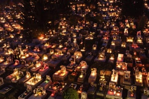 All saints day: Candles burn on graves to mark All Saints' Day in a cemetery, Hugary