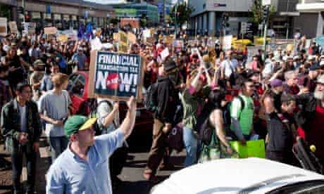 Protesters march towards a Bank of America branch in the city