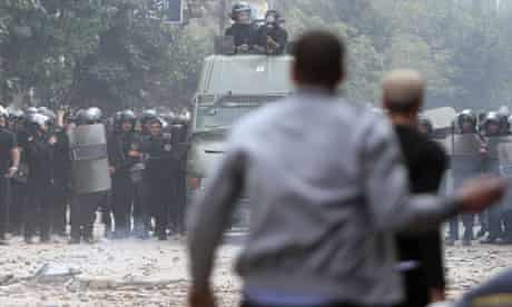 Egyptian riot police face off with protesters in Tahrir Square on Sunday