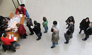 Spaniards queue to vote in the general elections in Barcelona