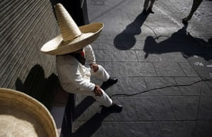 24 hours in pictures: Mexico City, Mexico: A soldier wearing traditional revolutionary costume