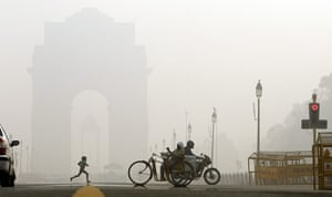 24 hours in pictures: New Delhi, India: A young child runs near India Gate in the morning fog