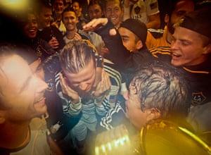 Beckham MLS: David Beckham, center left, celebrates with his teammates
