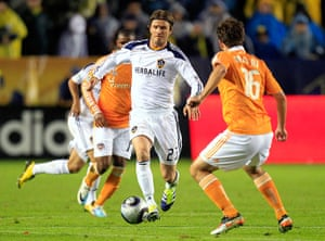 Beckham MLS: Beckham dribbles the ball against the Houston Dynamo during MLS Cup final