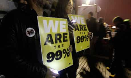Occupy Wall Street demonstrators hold signs