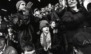 children in football crowd