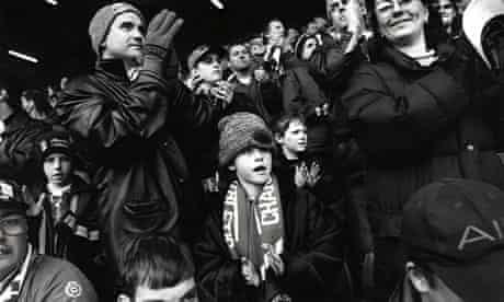 children in football crowd