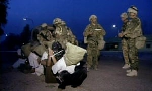 British troops round up suspected Ba'ath party activists in Basra, Iraq