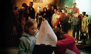 kids using worksheet in a museum