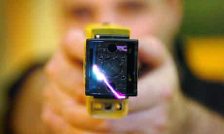 A police officer demonstrates the use of a Taser gun