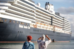 24 hours in pictures: A tourist takes a photo of a cruise ship in Old San Juan, Puerto Ric