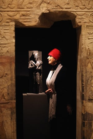 24 hours in pictures: Woman views a statue of King Taharqa at The Ashmolean Museum, Oxford