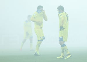 24 hours in pictures: Smoke from flares blankets the pitch as Apoel players react, St. Petersburg