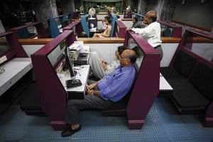 24 hours in pictures: Stockbrokers follow share prices at the Karachi Stock Exchange