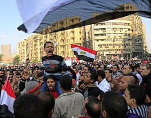 Tahrir Square: Protesters  shout slogans against the ruling military council