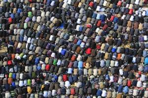 Tahrir Square: Demonstrators take part in Friday prayers