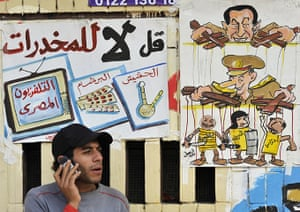 Tahrir Square: A protester talks on his mobile phone