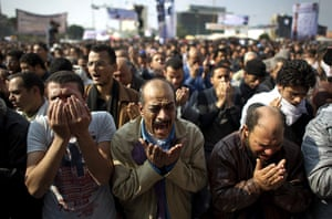 Tahrir Square: Egyptian men perform the Friday prayer in Tahrir square