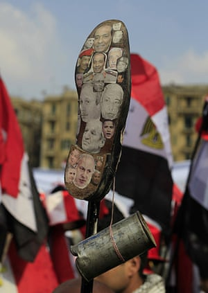 Tahrir Square: leaders images on the sole of a shoe