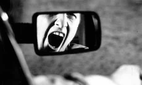 Man shouting in car