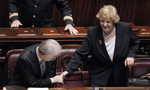 Italy's prime minister, Mario Monti, shakes hand with the interior minister, Anna Maria Cancellieri
