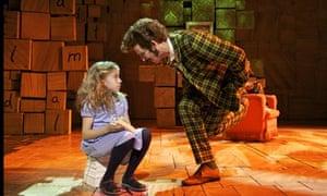 Sophia Kiely as Matilda and Paul Kaye as Mr Wormwood in Matilda the Musical