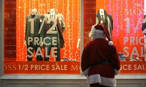 'Father Christmas' looks at a pre-Christmas sales advert