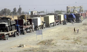 Trucks carrying Nato supplies wait for clearance at Pakistan's border with Afghanistan in Chaman
