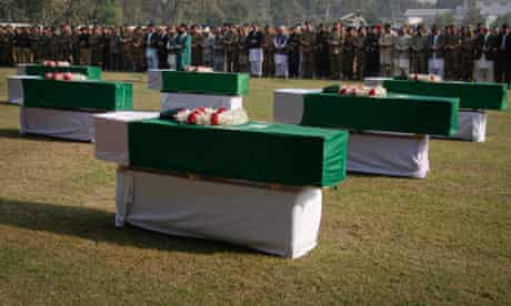 Pakistani flags cover the coffins of soldiers killed in the Nato border attack on Saturday