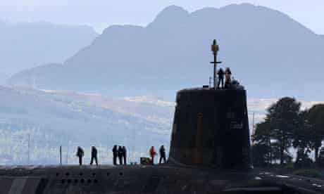 A Vanguard class nuclear submarine carrying Trident nuclear missiles sets sail from Faslane