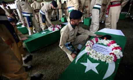 Pakistani soldiers pay their last respects to their colleagues