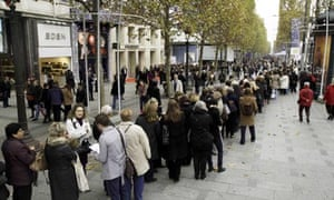 Customers queue for the opening of the Marks & Spencer on the Champs-Elysees, Paris, last week