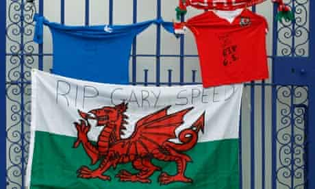 Tributes to Wales manager Gary Speed are left on a gate outside Cardiff City's stadium
