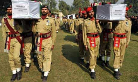 Pakistani soldiers carry the coffins of comrades. 27/11/11