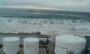 Tsunami waves approach the Fukushima Daiichi nuclear power plant