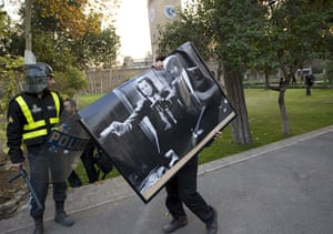 Tehran embassy: A protester walks with a poster from the British embassy in Tehran