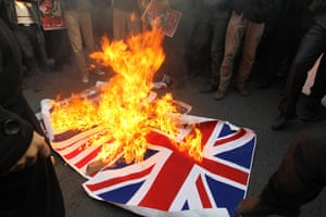 Tehran embassy: Iranian protesters burn the British flag outside the embassy in Tehran