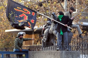Tehran embassy: Iranian protesters wave a flag that reads Oh Hussein