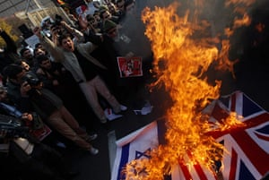 Tehran British embassy: Protesters set fire to the British and Israeli national flags