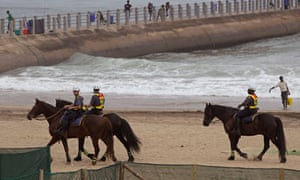 South African mounted police provide security during the Durban climate conference