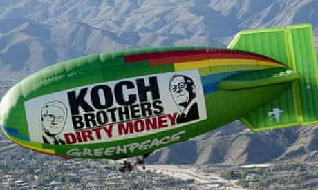 David and Charles Koch - shown on a Greenpeace protest blimp