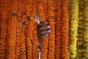 FTA: Navesh Chitrakar : A customer selects garland made of marigold flowers